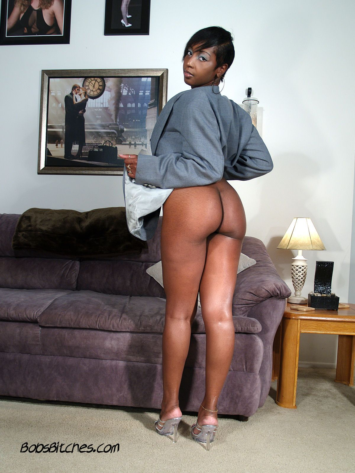 Sage, the ebony milf exposes her big black booty and sexy legs in high heels.