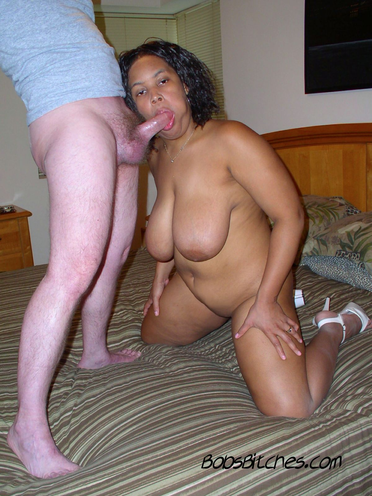 Double D Dede is a big tit ebony milf that loves to suck white dick, and she gets a jaw fucking.