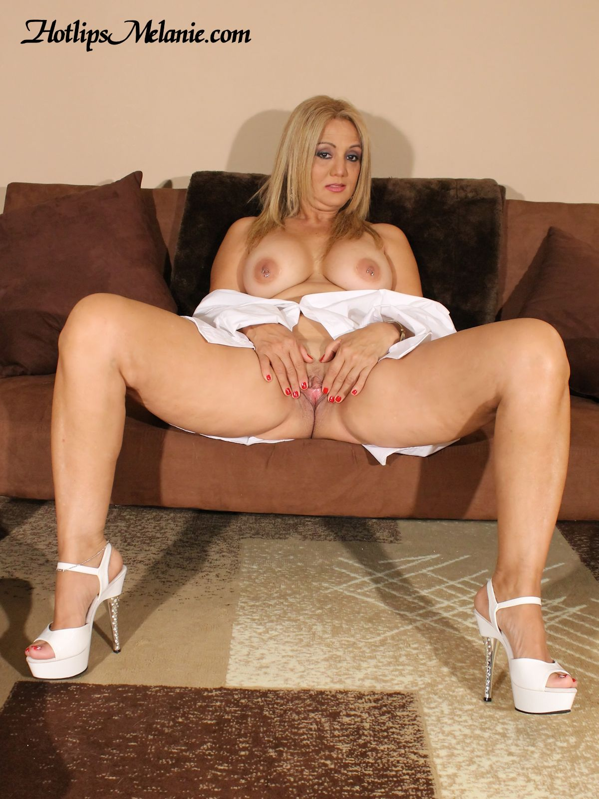 Hotlips Melanie spreads her high heeled, thick legs, and pussy lips.