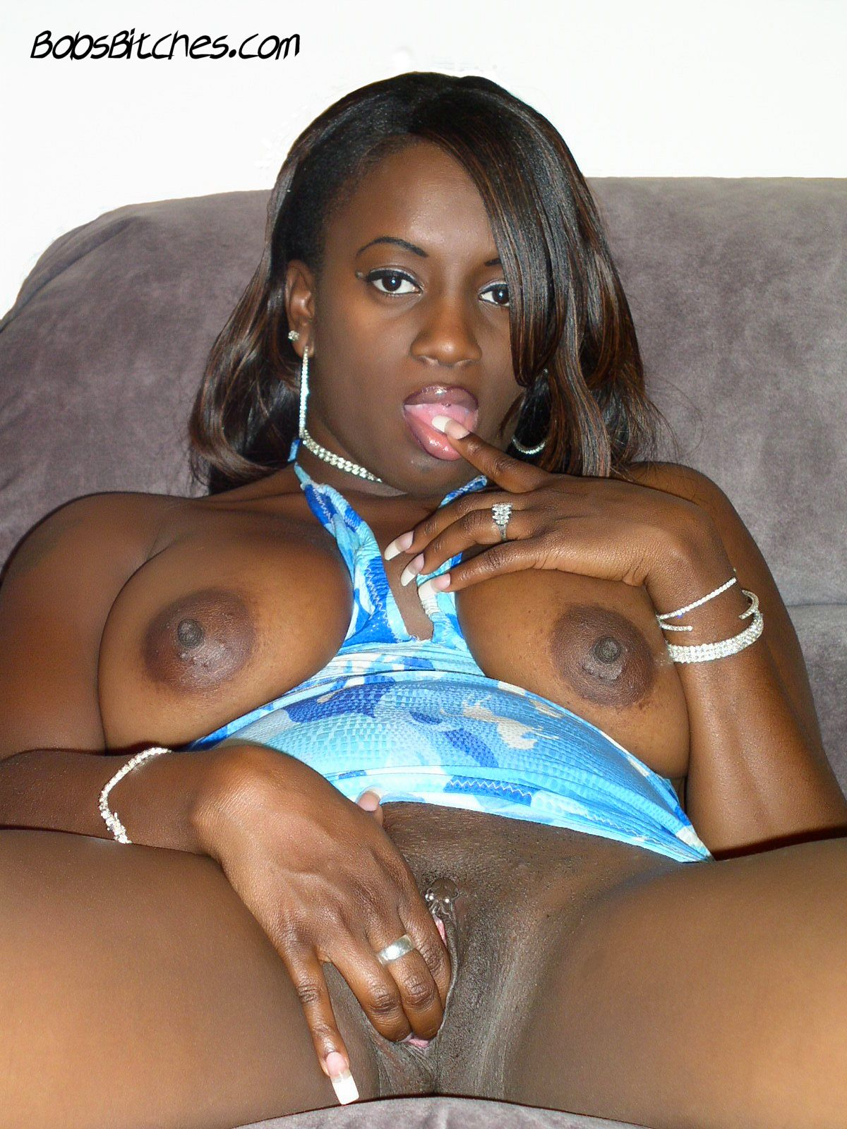 Big tit ebony milf, Destiny, fingers her pussy and large labia lips.