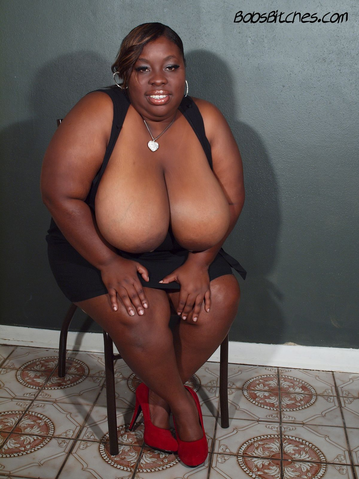 High heeled big tit black bbw, Latoya Sax shows off her huge boobs.