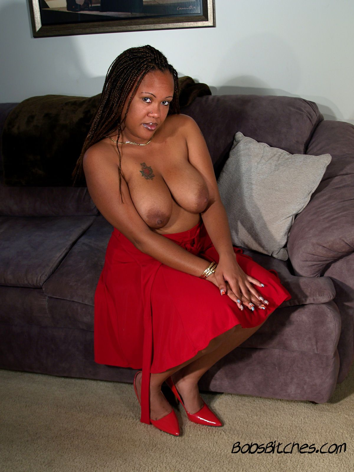 High heeled, big tit, Margarita, exposes her large areolas.