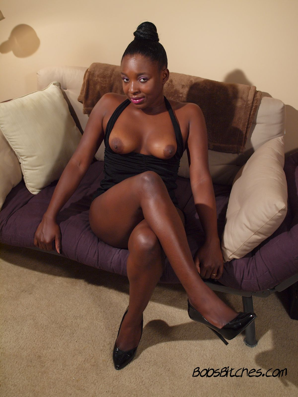 High heeled, slim ebony glamour babe, Jasmine, shows off her sexy legs and perky tits.