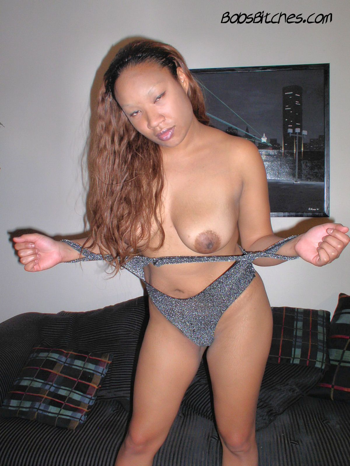 Exotic mixed ebony and asian beauty, Mia, exposes her natural boobs.