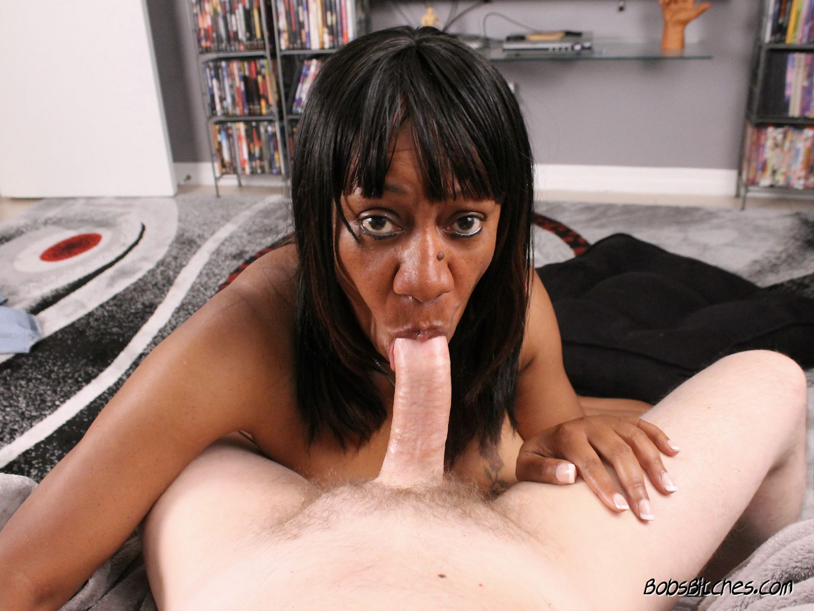 Ebony milf, Ginger, sucks white cock.