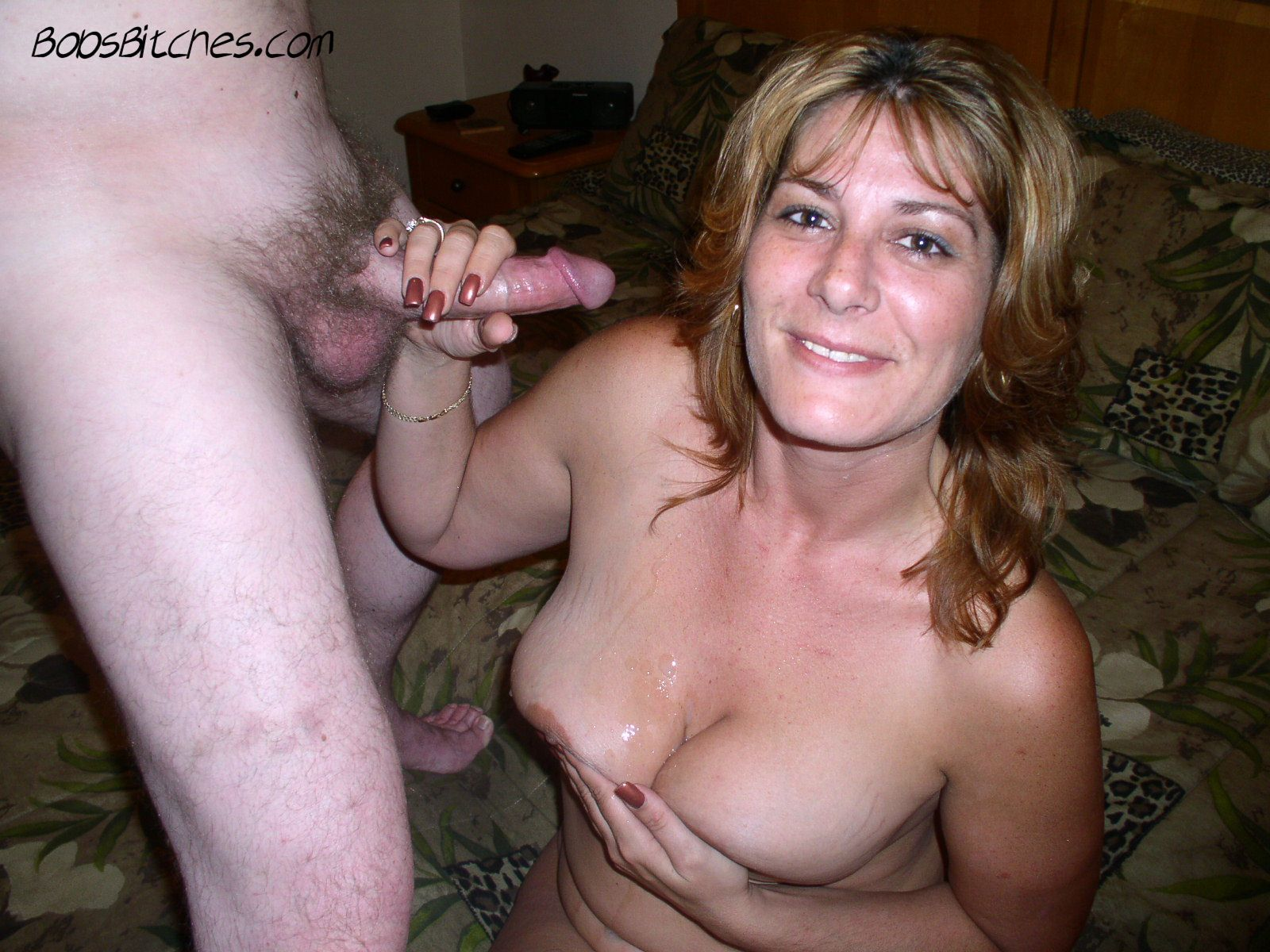 Big tit swinger wife covered in cum after sucking cock.