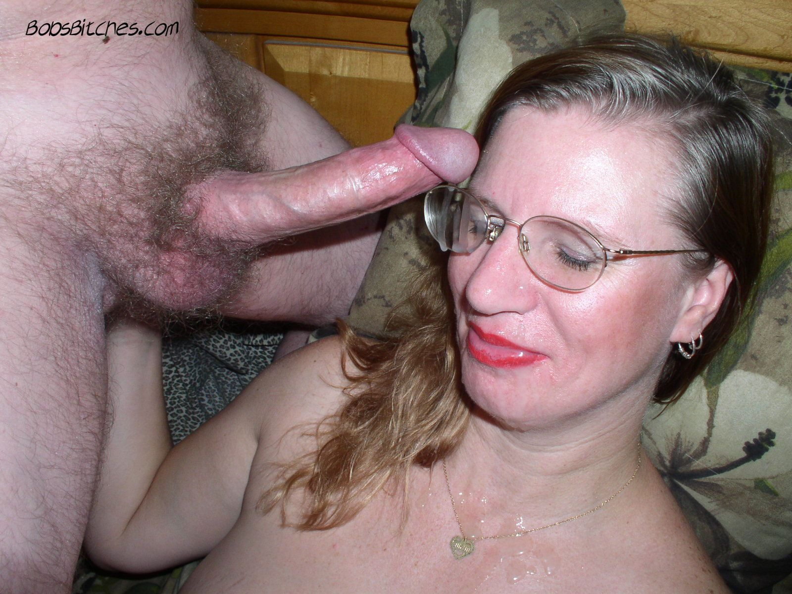 Milf Karen is in bed, wearing glasses while sucking cock and takes a load of cum on her face.