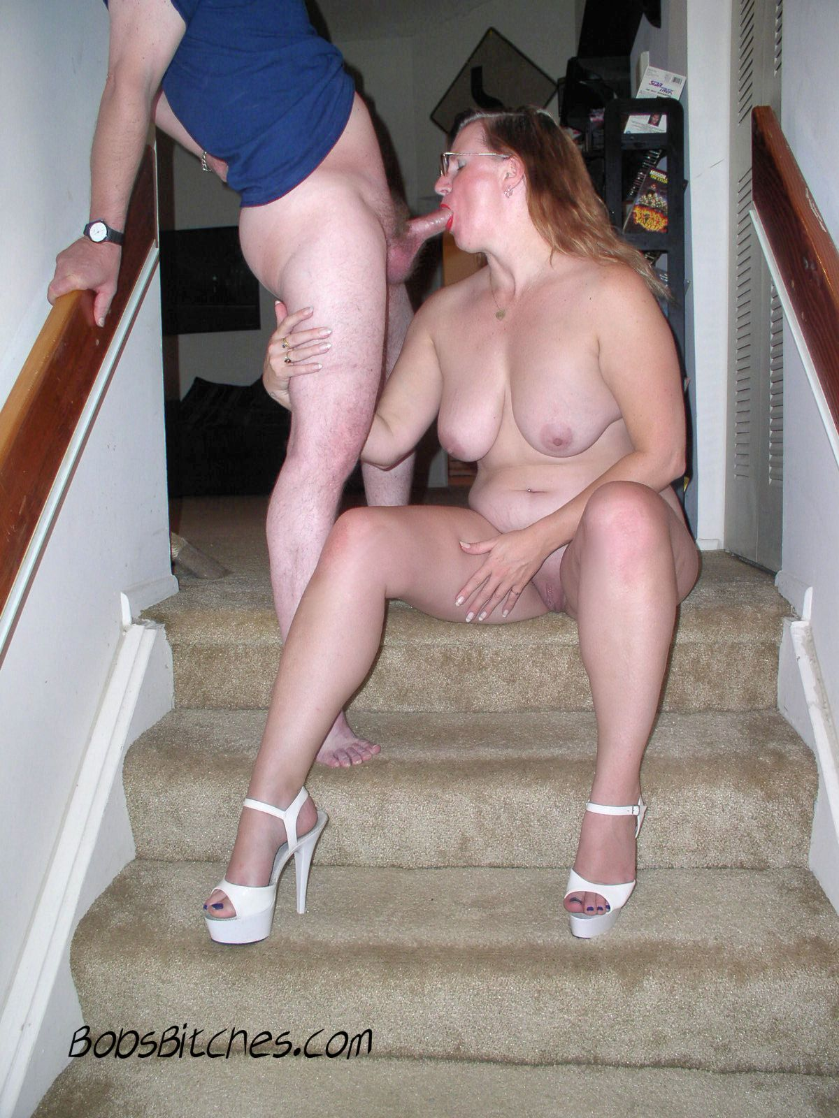 Setting on stairs, bitch Karen, the  sex addict milf sucks my dicks spreading her high heeled legs exposing her pussy.