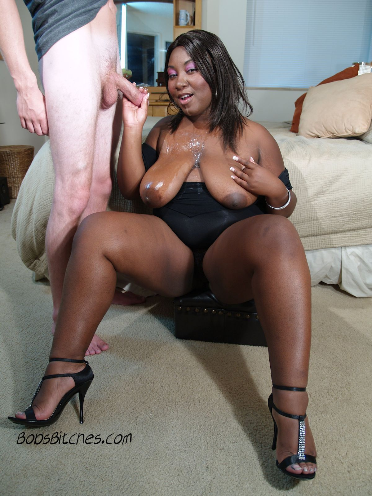 Big tit black bitch gets sprayed with cum from two white dicks.