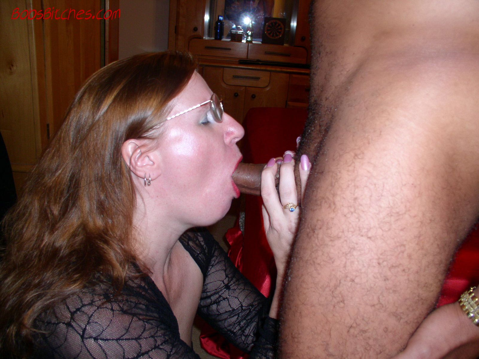 Whir wife deep throats a black cock while her husband watches and photographs.