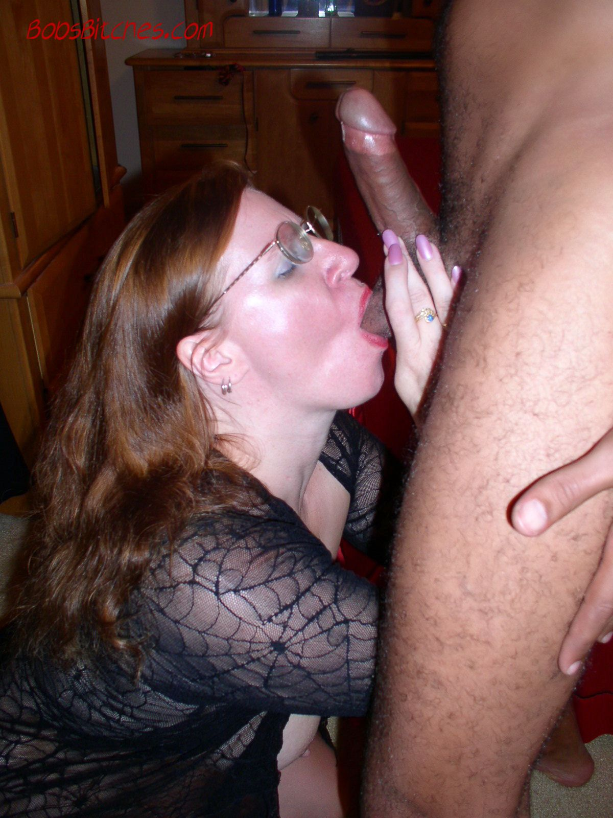 White swinger Milf Karen worships a big black cock and sucks his balls.