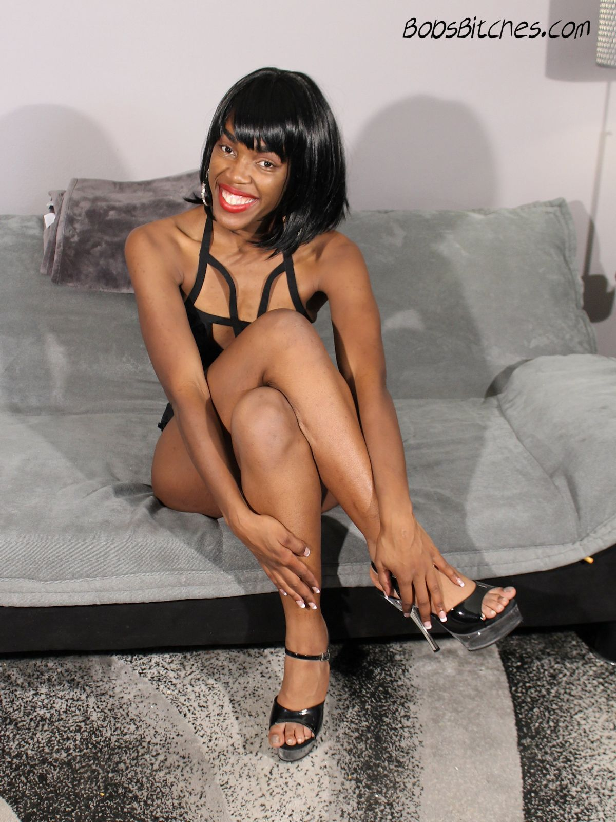 Thick lipped ebony beauty in high heels ready to suck a big white cock.