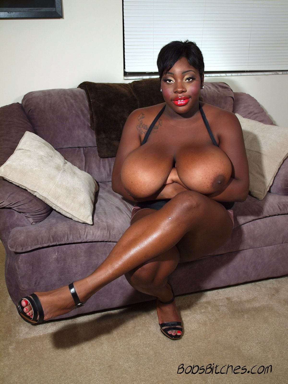 Jamie Sax exposes her massive black boobs.
