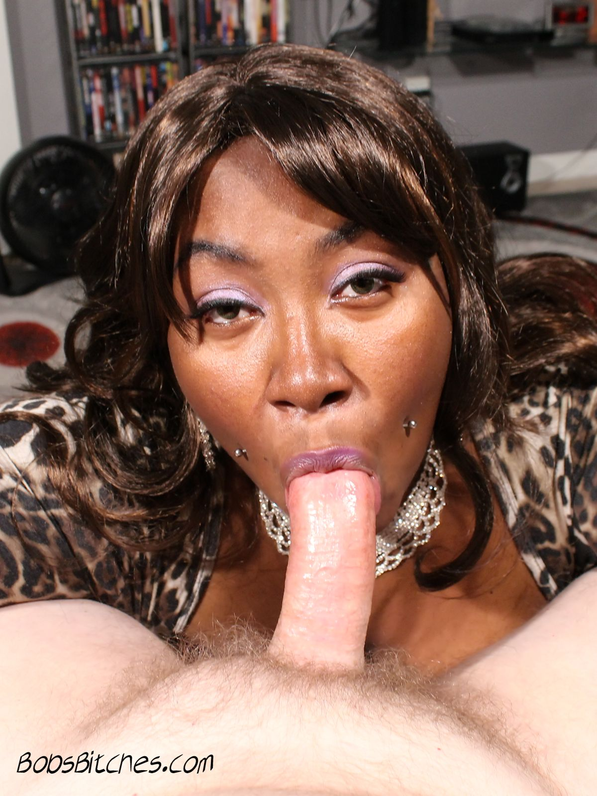 Ebony milf sucks a big white cock.