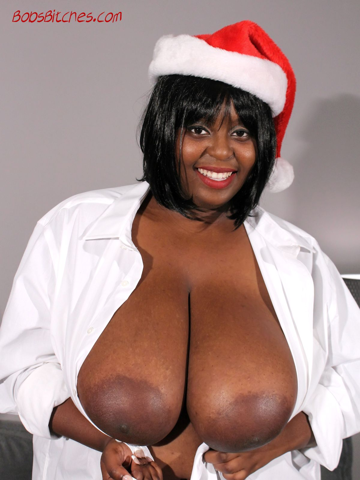 Big black tit, Montoya Hills, exposes her Christmas pillows and large areolas.