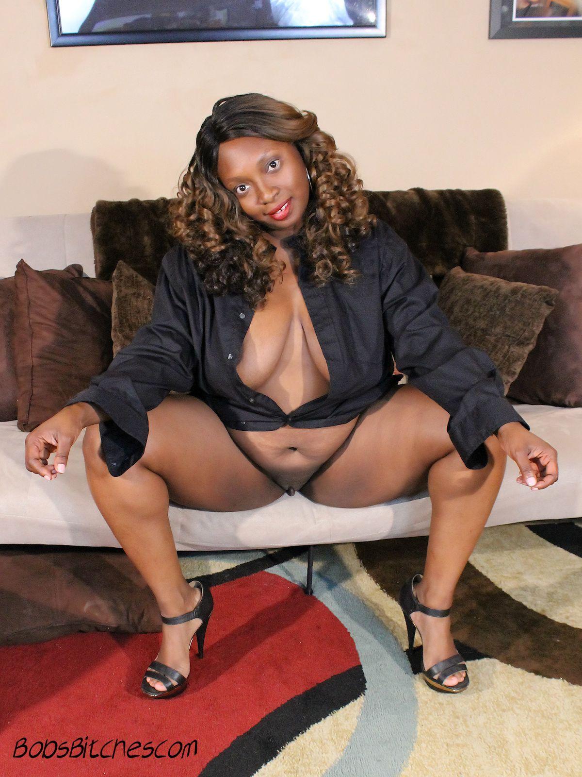 Big tit ebony milf spreading her high heeled legs.