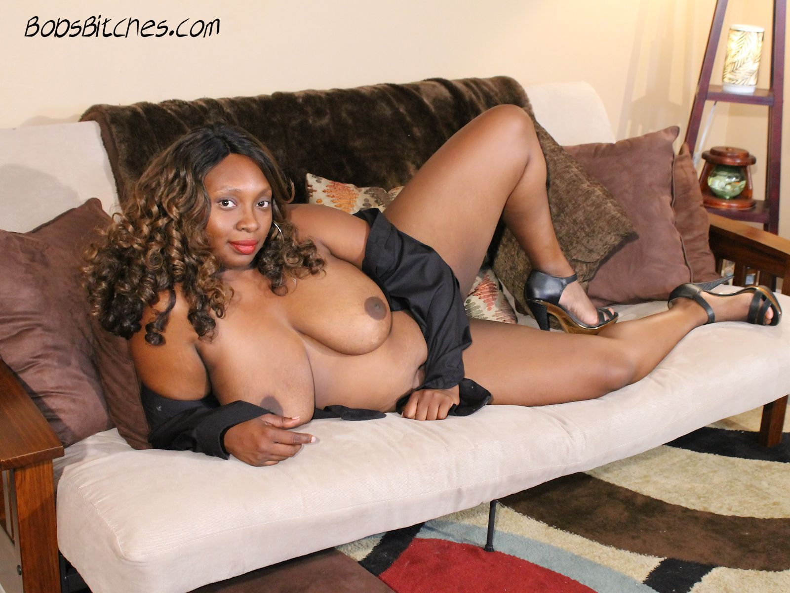 All natural, big tit ebony milf, Symone Banks  reveals her voluptuous body.