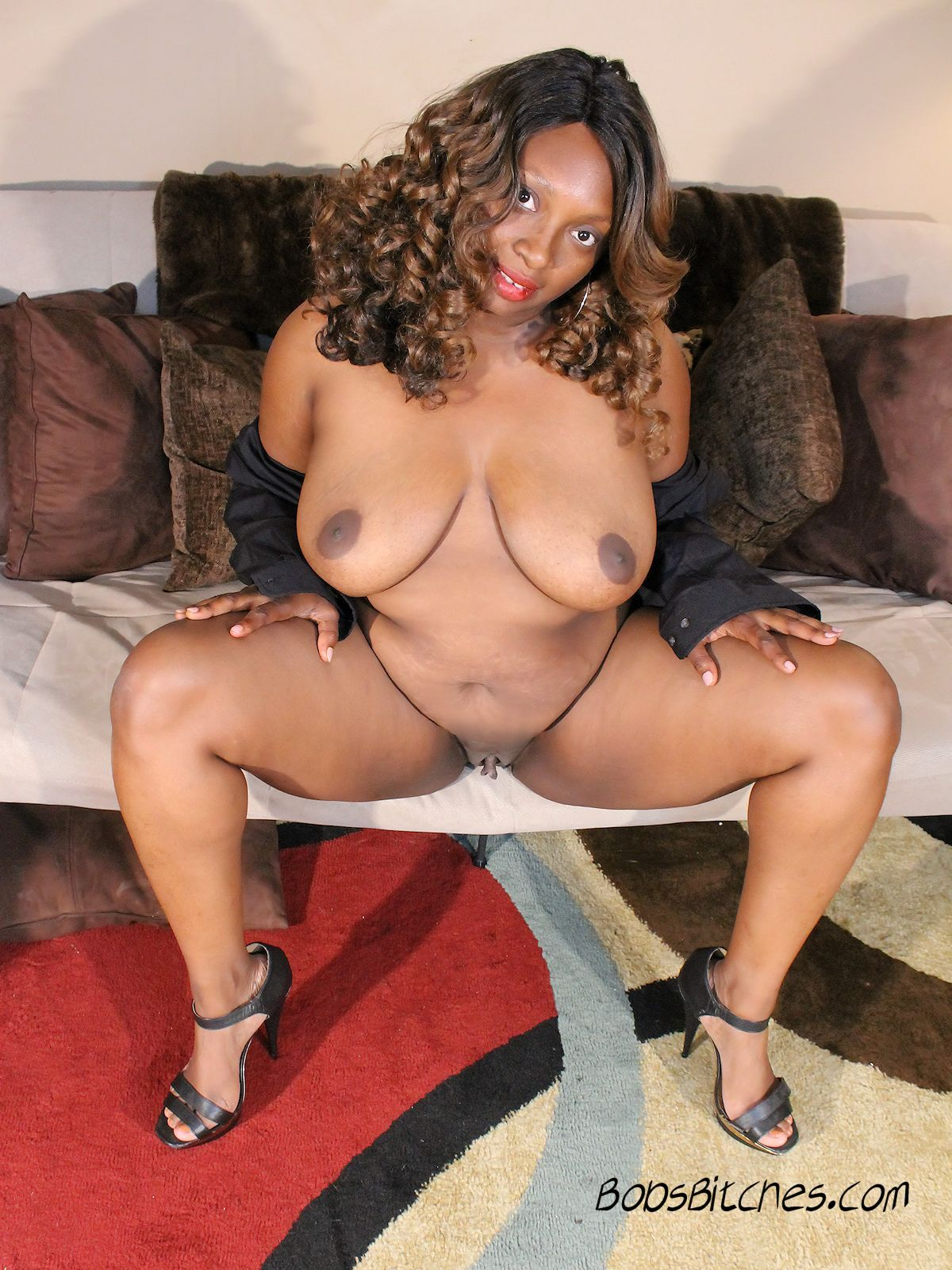 High heeled ebony mom spreads her legs and shows her large labia.